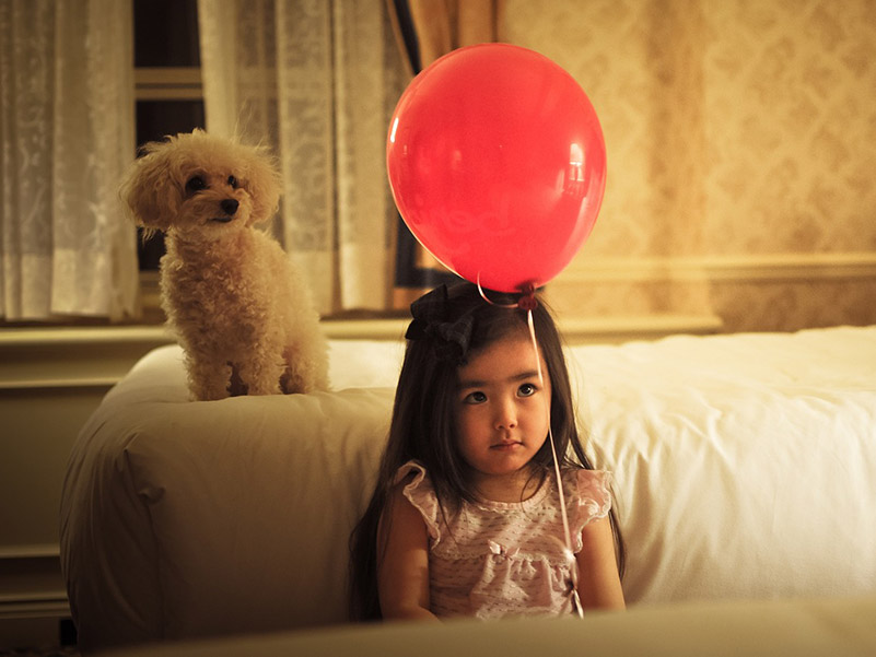 Girl with dog and balloon