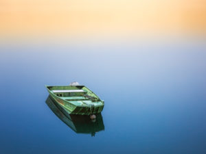 Boat floating on calm waters